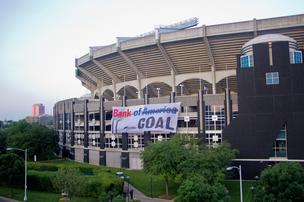 Trained climbers scaled the walls of Bank of America Stadium to hang a 70-foot banner protesting the bank's practice of financing coal projects.
