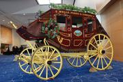 A Wells Fargo stagecoach, decorated for Christmas, was stationed in the lobby at the bank's event Thursday.