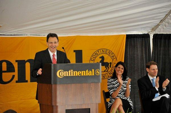 Jochen Etzel, chief executive of Continental Tire the Americas, speaks at the groundbreaking event for the Sumter tire plant, with Gov. Nikki Haley among those applauding.