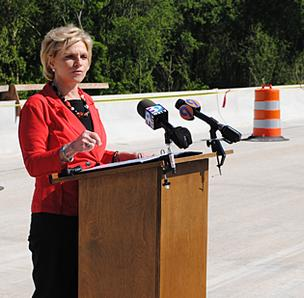 Gov. Bev Perdue speaks last week about the economic benefit of replacement bridges over the Yadkin River.