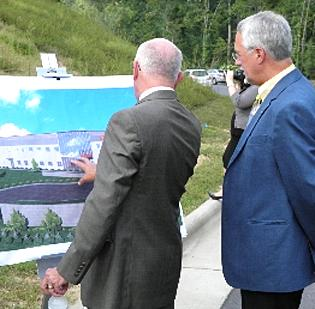 Participants look over a rendering at yesterday's groundbreaking for Hydac Technology Corp. in Lincoln County.