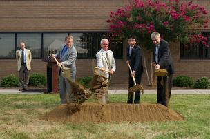 Left to right, John Cox, president of Cabarrus Regional Development; Concord Mayor Scott Padgett; Hiroshi Suda, president of Oiles America; and 8th District Congressman Larry Kissell were among the officials who participated in groundbreaking ceremonies Tuesday at Oiles America's facility in Concord.