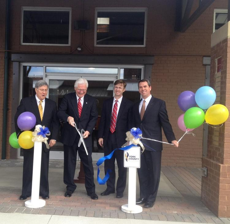 The Old Town Market Hall was dedicated by, left to right, Rock Hill Mayor Doug Echols, John Rinehart Sr. of Rinehart Realty Corp., Kyle Curtis of Park Sterling Bank and Andy Shene of First Citizens Bank.