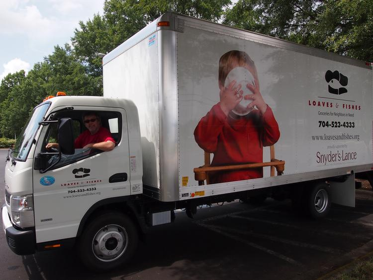 The 18-foot-long delivery truck will be used to supply Loaves & Fishes' network of 19 food pantries in the Charlotte area.