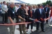 Hunter snips the ribbon at the RSI expansion dedication today.