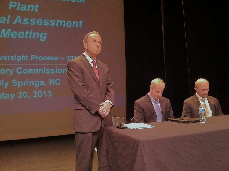 Ernie Kapopoulos, site vice president for the Shearon Harris nuclear plant, prepares for Monday's public meeting about the plant. Seated to his left are Plant Manager John Duffner and Regis Repko, senior vice president for the Harris and Brunswick nuclear plants.