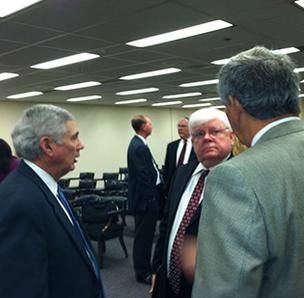 Attorney Dwight Allen (center) spoke for Duke Energy today at an N.C. Utilities Commission meeting to consider the settlement that ended its investigation of the utility.