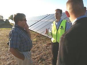 Joel Olsen, center, describes O2Energies 3.5-megawatt Progress Solar 1 project.