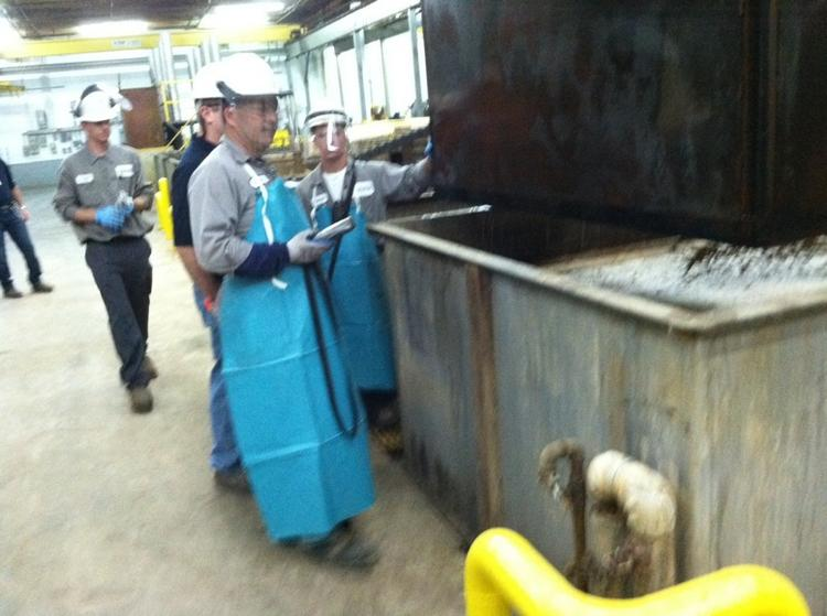 Workers at the Steag plant in Kings Mountain process catalyst.