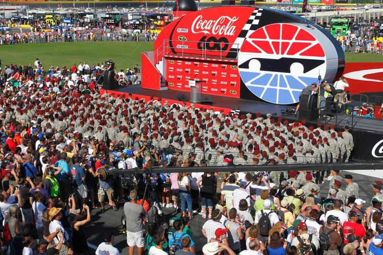 Charlotte Motor Speedway is pairing companies and veterans for the NASCAR races this month.