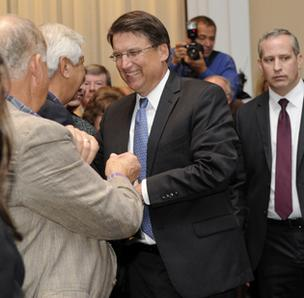 Pat McCrory greets supporters at the Westin Charlotte, where he delivered his acceptance speech after winning the governor's office.