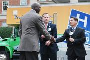 Michael Jordan shakes hands with Carl Armato of Novant Health and Mark Billings of Presbyterian Healthcare at a press conference between Jordan's Charlotte Bobcats and the health-care providers.