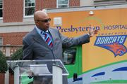Charlotte Bobcats President Fred Whitfield gestures towards Presby's Community Care Cruiser as he talks about highlights of the partnership.