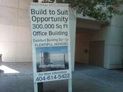 Portman placed a sign at the site last year to advertise the office building opportunity.