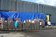 Girl Scout cookies on pallets awaiting pick-up