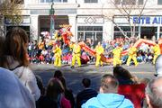 A group carries a Chinese dragon in the 2012 Belk Carolinas Carousel Parade, held Thanksgiving Day in uptown Charlotte.