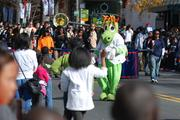 All of Charlotte's major sports teams were represented in the 2012 Belk Carolinas Carousel Parade on Thanksgiving Day. Here, the Charlotte Knights' Homer the Dragon greets onlookers.