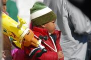 A young onlooker holds an inflatable Spongebob from one of the street vendors at the 2012 Belk Carolinas Carousel Parade, held Thanksgiving Day in uptown Charlotte.