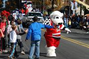 All of Charlotte's major sports teams were represented in the 2012 Belk Carolinas Carousel Parade on Thanksgiving Day. Here, the Charlotte Checkers' mascot, Chubby, high-fives some young spectators.