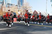 Bagpipers with the Charlotte Fire Department marchin the 2012 Belk Carolinas Carousel Parade, held Thanksgiving Day in uptown Charlotte.