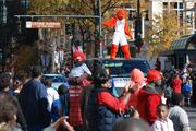 All of Charlotte's major sports teams were represented in the 2012 Belk CarolinasCarousel Parade on Thanksgiving Day. Here, the Charlotte Bobcats' mascot dances atop a van.