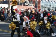 Ladies from Charlotte-area seniors facilities march as cheerleaders in the 2012 Belk Carolinas Carousel Parade, held Thanksgiving day in uptown Charlotte.