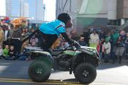 Sir Purr, the Carolina Panthers' mascot, zooms past spectators atthe 2012 Belk Carolinas Carousel Parade, held Thanksgiving Day in uptown Charlotte. All of the city's major sports teams were represented in the parade,named on the nation's best by U.S. News Travel.