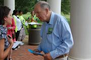 Former Congressman John Spratt (D-S.C.), right, chats with delegates at Daniel Stowe Botanical Garden.