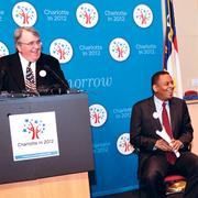 Insurance executive Cameron Harris (left) and Charlotte Mayor Anthony Foxx were all smiles at the Feb. 1 DNC announcement at the Charlotte Chamber.