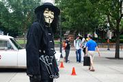 """""""V,"""" the main character from V for Vendetta, was among the costumed attendees at HeroesCon."""