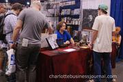 Convention-goers browse through booth after booth on the main floor.