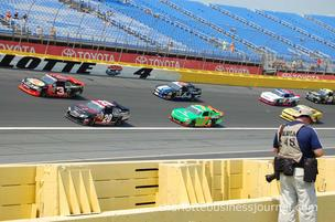 Drivers in the Nationwide Series NASCAR History 300 take the fourth turn at Charlotte Motor Speedway on May 26. Brad Keselowski won the race, his first victory in the series this year and the 18th of his career.