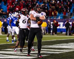 Cincinnati Bearcats tight end Travis Kelce celebrates after scoring the decisive touchdown during the Belk Bowl vs. the Duke Blue Devils at Bank of America Stadium in Charlotte on Dec. 27, 2012. Cincinnati won 48-34.