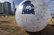 A giant baseball notes the team's pending return to Charlotte from Fort Mill.