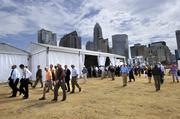 Friday's ceremonies drew a crowd to the stadium site off Mint and East Third streets.
