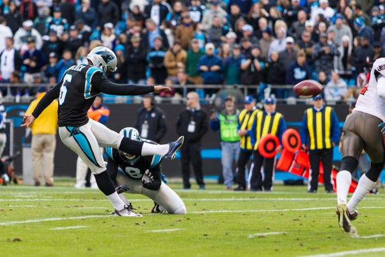 Justin Medlock kicks his final extra point for the Panthers in the Nov. 18 game against Tampa Bay.