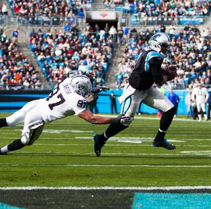Carolina Panthers quarterback Cam Newton breaks away from defenders on his way to the end zone for a touchdown during a Dec. 23, 2012, game vs. the Oakland Raiders at Bank of America Stadium in Charlotte.