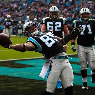 Carolina Panthers wide receiver Steve Smith celebrates a touchdown by throwing the ball into the stands during a Dec. 23, 2012, game vs. the Oakland Raiders at Bank of America Stadium in Charlotte.