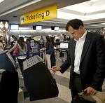 American Airlines speeds up lines with DIY bag tagging at MIA