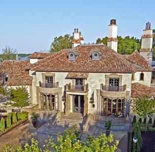 Seven ultra-luxury homes in the Lake Norman area have gone under contract in recent weeks, according to a report from WCNC-TV. Chateau Lyon, the estate pictured here, was sold last year by Lake Norman Realty Inc.