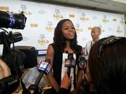 Two-time Olympic gold medalist Gabrielle Douglas answers reporters' questions at the Kids' Health Goes Gold event Wednesday.