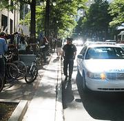 Charlotte-Mecklenburg Police kept an eye on the Occupy Charlotte demonstration Saturday afternoon, which was held peacefully.