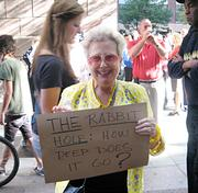 "Marie Rake, who identified herself as an ""old broad"" on one of her signs, teased that she had ""one foot on the banana peel, on the way out."" She says she came to support the young people who organized the movement."