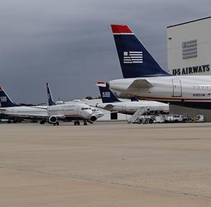 About 90 US Airways planes were grounded at Charlotte Douglas International Airport during Hurricane Sandy. As of Friday, the airline has restored its normal operating schedule.