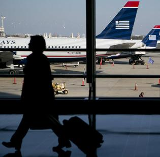 US Airways reported a 1 percent decrease in the number of passengers that boarded its planes in February compared with the same month of last year.