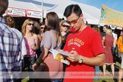A beer fan uses the program guide to determine which direction to go next.