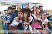 The Charlotte Oktoberfest Beer Girls posed for photos with attendees, charging a small fee and donating the money to the event's chosen charities.