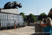 Fans posed for photos with the giant panther statues outside Bank of America Stadium.