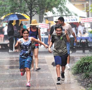 Monday's CarolinaFest celebration attracted 30,000 visitors uptown. Then afternoon thunderstorms sent them running for cover.
