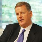 US Airways CEO Doug Parker may soon bring merger talk to Chicago
